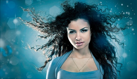 Woman with a long beautiful hair on blue background Stock Photo - 8881158