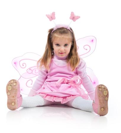 girl magic wand: Little girl in fairy costume on white background