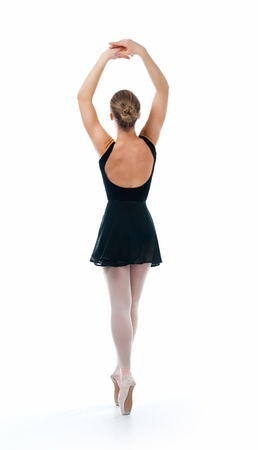 a young wonderful ballerina is dancing gracefully photo