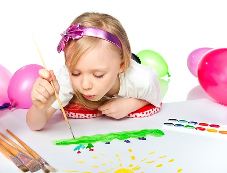 Adorable little girl drawing artwork photo