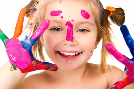 kids painting: little girl with paint Stock Photo