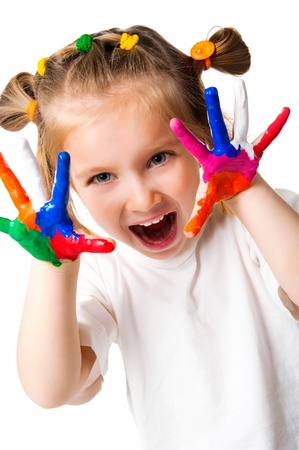 children painting: smiling girl with the palms painted by a paint.