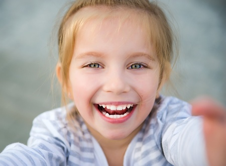 little girl smiling: beautiful liitle girl Stock Photo