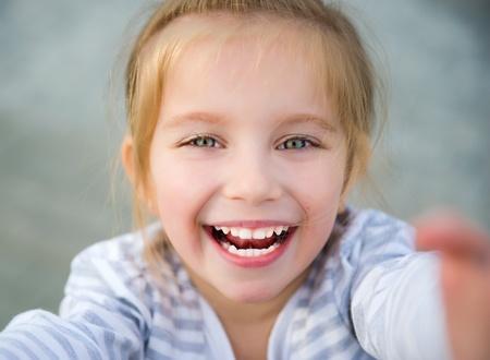 kid smiling: beautiful liitle girl Stock Photo