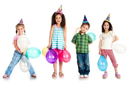 Kids in birthday caps Stock Photo