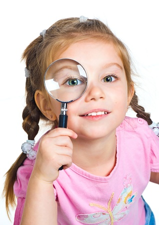 little girl looking through a magnifier Stock Photo - 9514157
