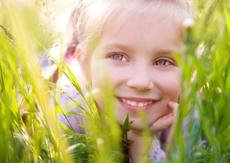 Cute little girl  on the meadow photo