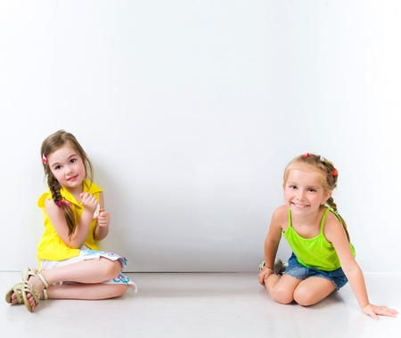 cute little girls: Cute little girls isolated Stock Photo