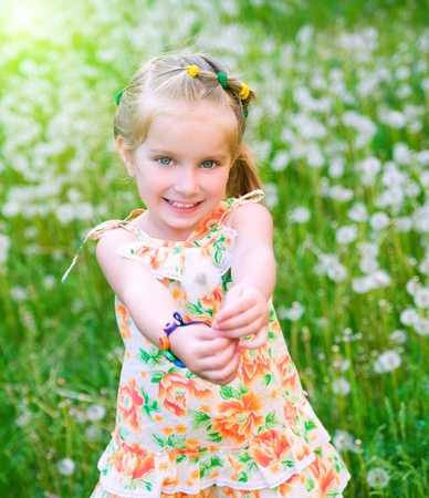 little blonde girl: Cute little girl  on the meadow