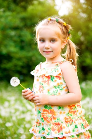 little girl smiling: Cute little girl  on the meadow