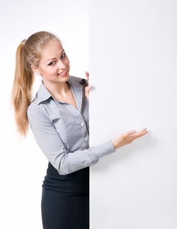 Businesswoman standing behind blank whits billboard photo