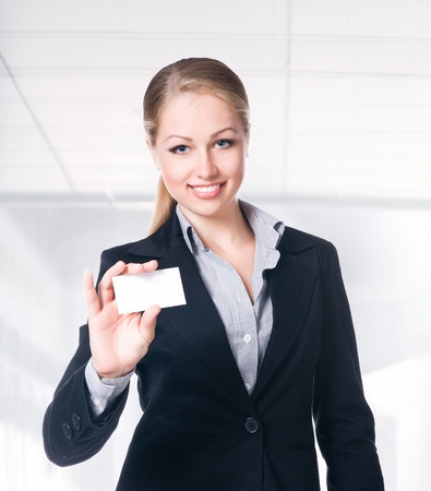 businesswoman in black suit holding empty blank photo