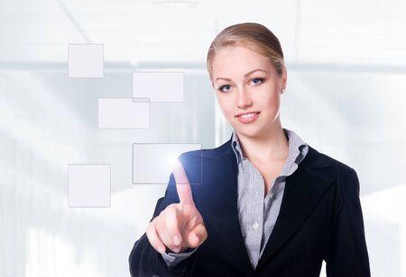 pressing: businesswoman pressing a touchscreen button Stock Photo