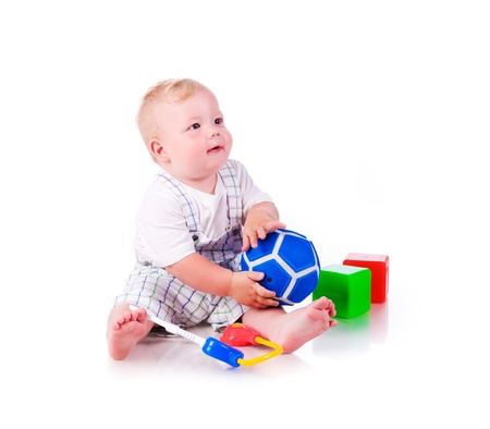 12 18 months: Little boy with a toys