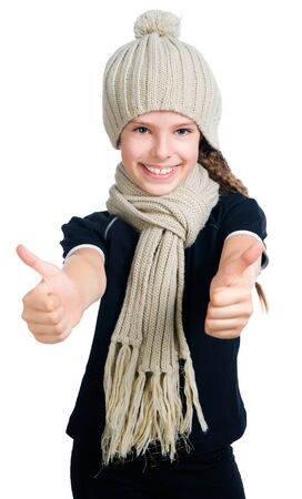 little girl in cap and scarf photo