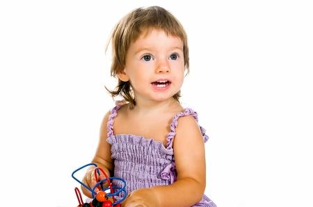 developmental: small baby with developmental toy Stock Photo