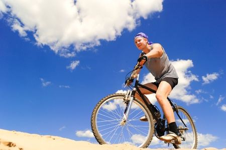 Young man riding a bike Stock Photo