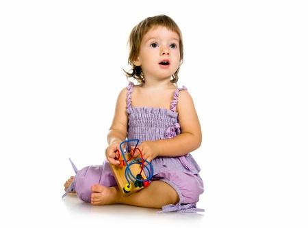 developmental: Small baby with developmental toy