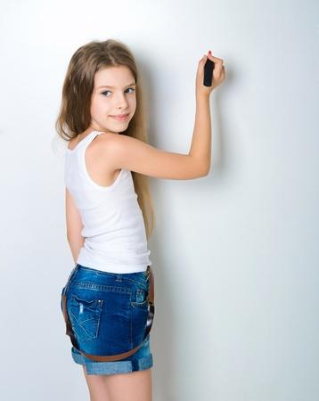 cute child behind a white board photo