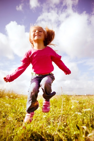 Little girl jumping Stock Photo