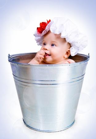 bathe: baby on a bucket