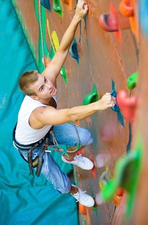 men climbing on a wall photo