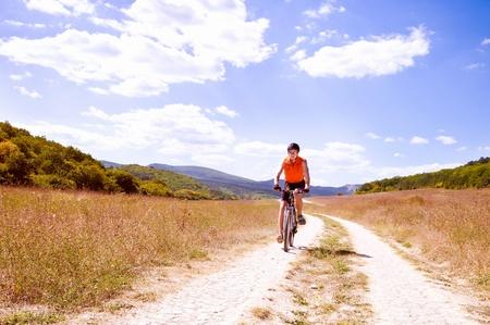 handlebars: man with hismuontain-bike Stock Photo