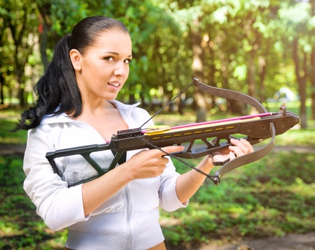 crossbow: beautiful young girl with arbalest Stock Photo