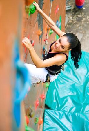 climbing sport: women climbing on a wall