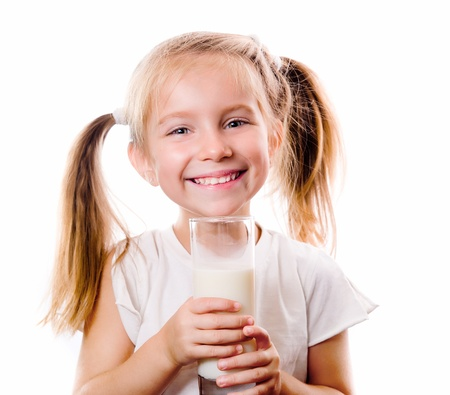 drinking milk: little girl holding a cup of milk Stock Photo