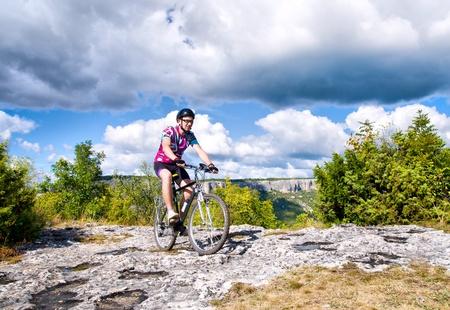 mountain biker: man with hismuontain-bike Stock Photo
