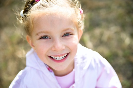 cute little girl smiling: beautiful liitle girl Stock Photo