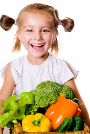 hungry kid: Little girl with the vegetables