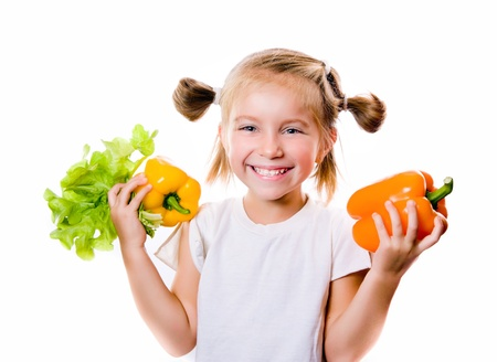 Little girl with the vegetables photo