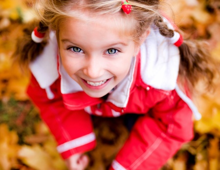 children only: Autumn portrait of a  little girl