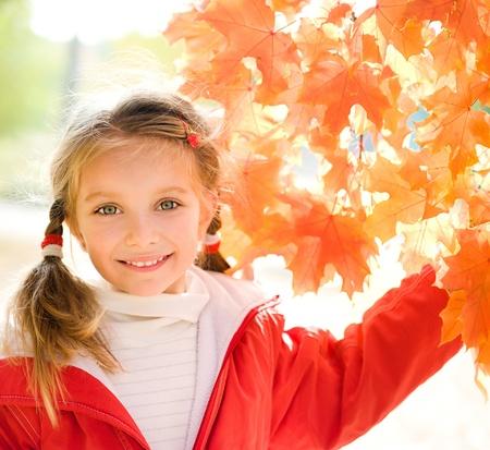 Autumn portrait of a little girl Stock Photo