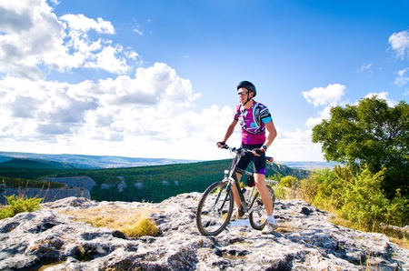 mountain bicycles: man with hismuontain-bike Stock Photo