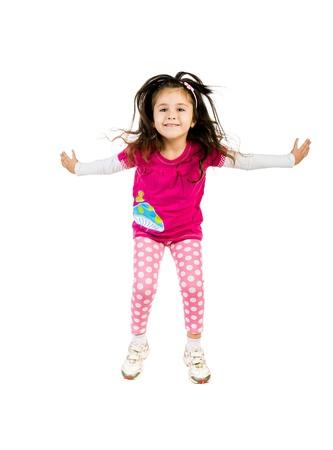Cute little girl jump. photo