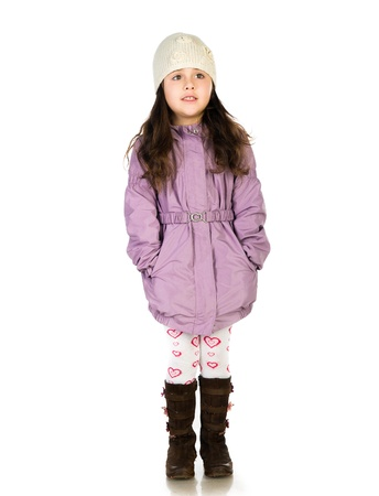 girl boots: little girl in a coat Stock Photo