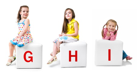 baby blocks: little kid on the block with letter Stock Photo