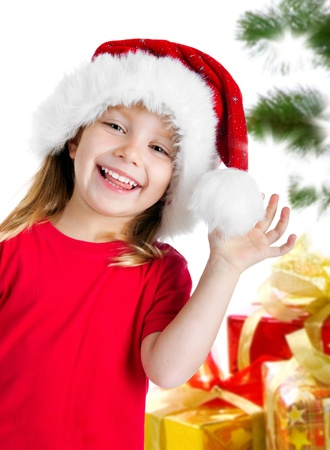 Pretty girl in santa claus hat photo