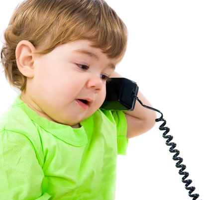 Little boy with the phon Stock Photo - 11555360