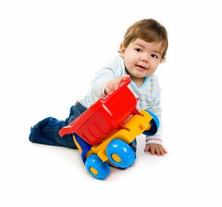 little boy  with a big car photo
