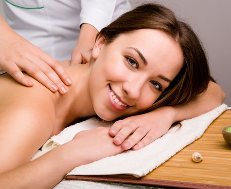 sensual massage: Pretty young women relaxing in the spa salon