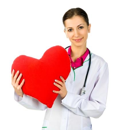 estetoscopio corazon: M�dico el cuidado de s�mbolo del coraz�n rojo sobre fondo blanco