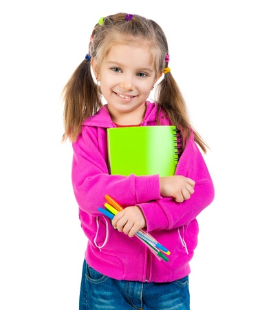 Cute schoolgirl with notebook on white background photo