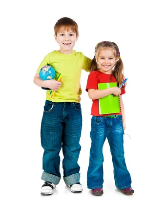 Cute kids with notebook and globe on white background photo