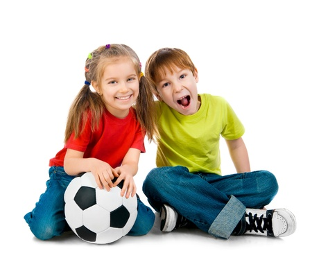soccer players: Small kids with soccer ball on white background Stock Photo