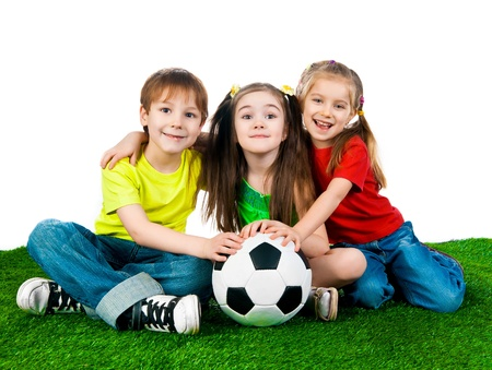 Small kids with soccer ball on white background photo