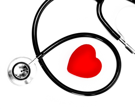 stethoscope and a red heart over a white background Stock Photo